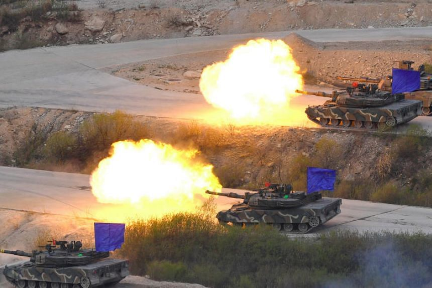 South Korean K1A2 tanks fire live rounds during a joint live firing drill between South Korea and the US at the Seungjin Fire Training Field in Pocheon, 65 kms northeast of Seoul, on April 26, 2017.