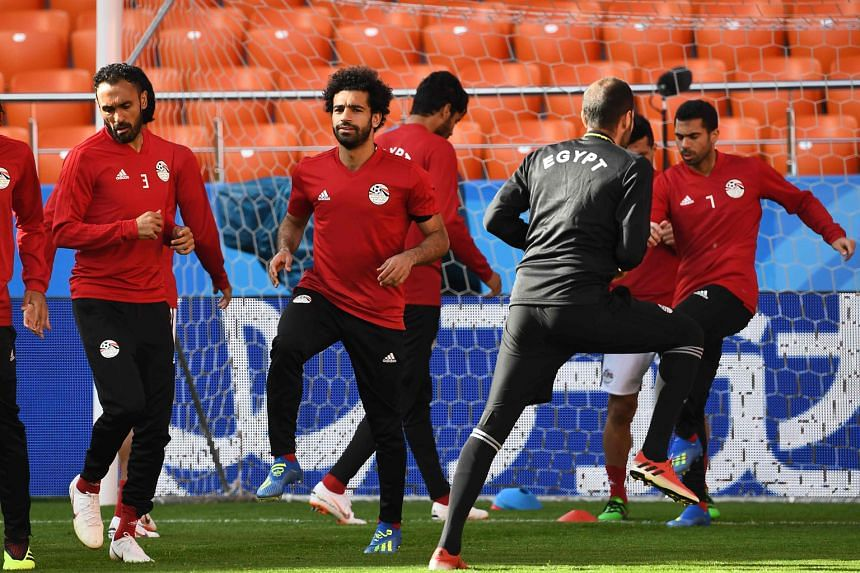 "Egypt's Mohamed Salah (second from left) is ""almost 100 per cent"" certain to play against Uruguay, according to national coach Hector Cuper, despite the forward's shoulder injury suffered in Liverpool's Champions League final defeat by Real Madrid on"