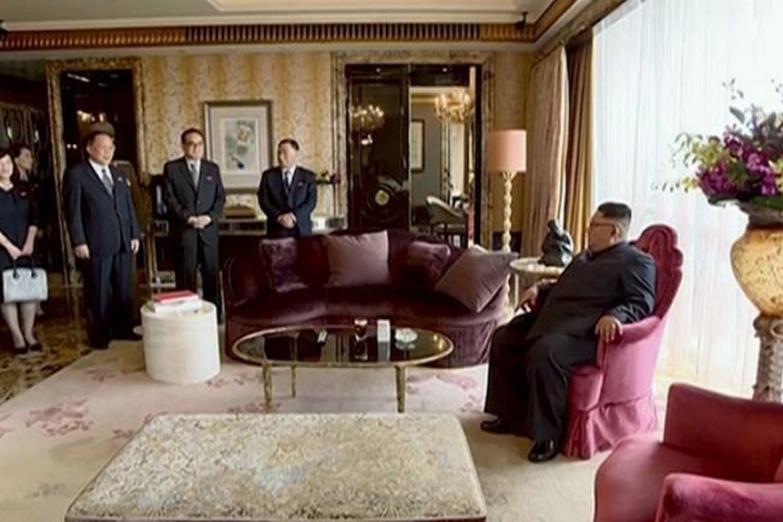 Still images showing North Korean leader Kim Jong Un in his hotel room in Singapore and on his plane, taken from a 40-minute broadcast by Korean Central Television. The propaganda push not only signalled his new confidence on the world stage after a