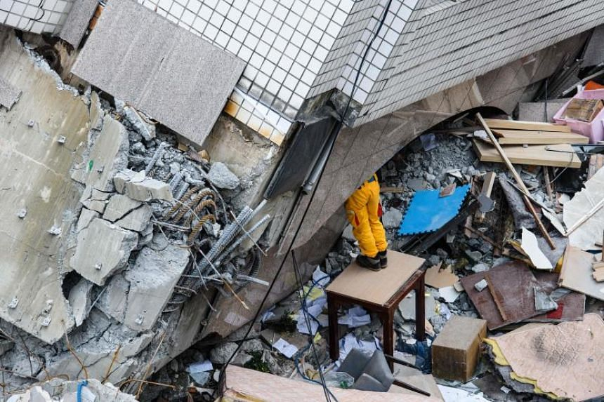 The lower floors of the 12-storey Yun Tsui residential building pancaked when a 6.4-magnitude quake struck the tourist hotspot of Hualien on Feb 6, 2018.