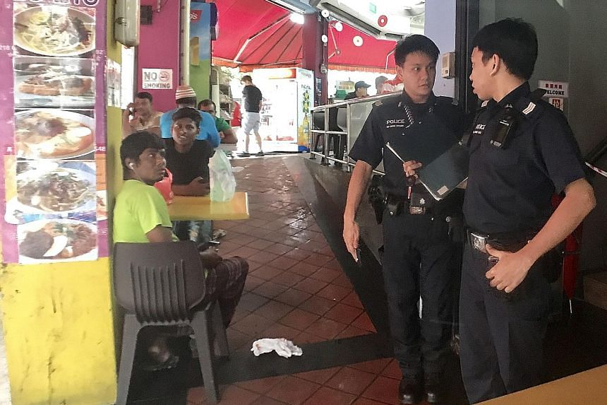 Police were alerted to the fight at 218 Geylang Road at about 7.50am and the officers cordoned off the area for about five hours. The suspect and the victim are both Malaysians.