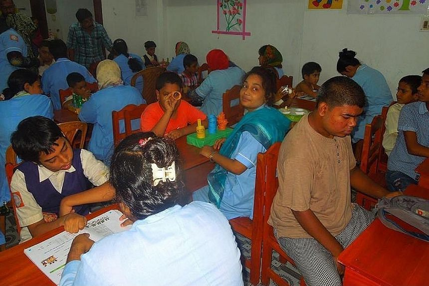 At the Unique Gift Foundation's school in Saidpur, Bangladesh, teachers provide support and assess the specific needs of the autistic child they are assigned to in one-on-one sessions.