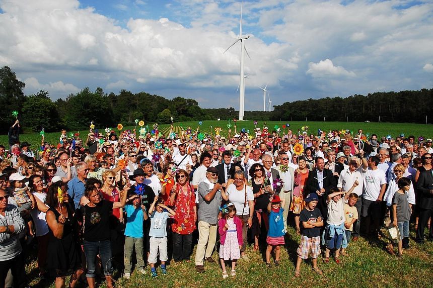 Inauguration of France's first citizen-built wind farm, in Brittany, in 2014. The dream of two men took 12 years and €12 million to be realised.