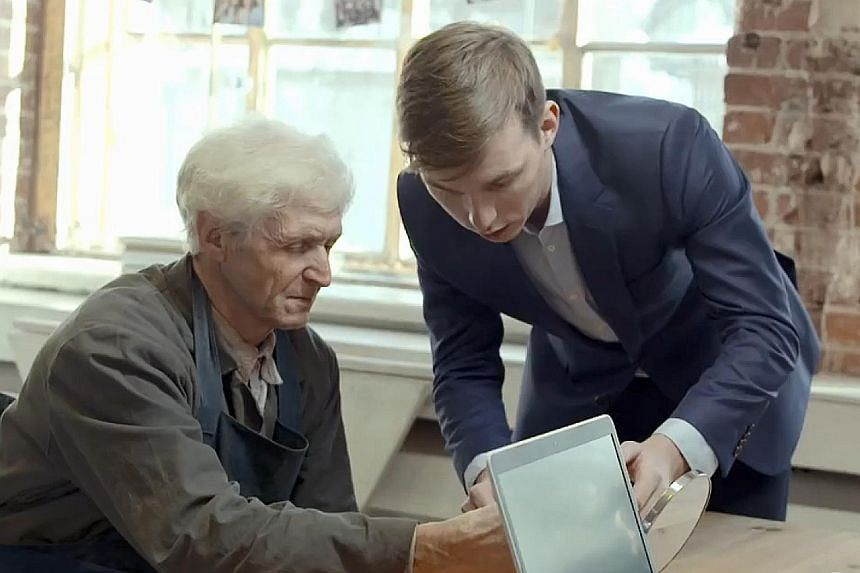 Engineer Mikhail Yanchikov (far right) testing the EyeMove app on a patient. By evaluating a person's eye movements, the app is able to detect certain neuro-degenerative diseases.