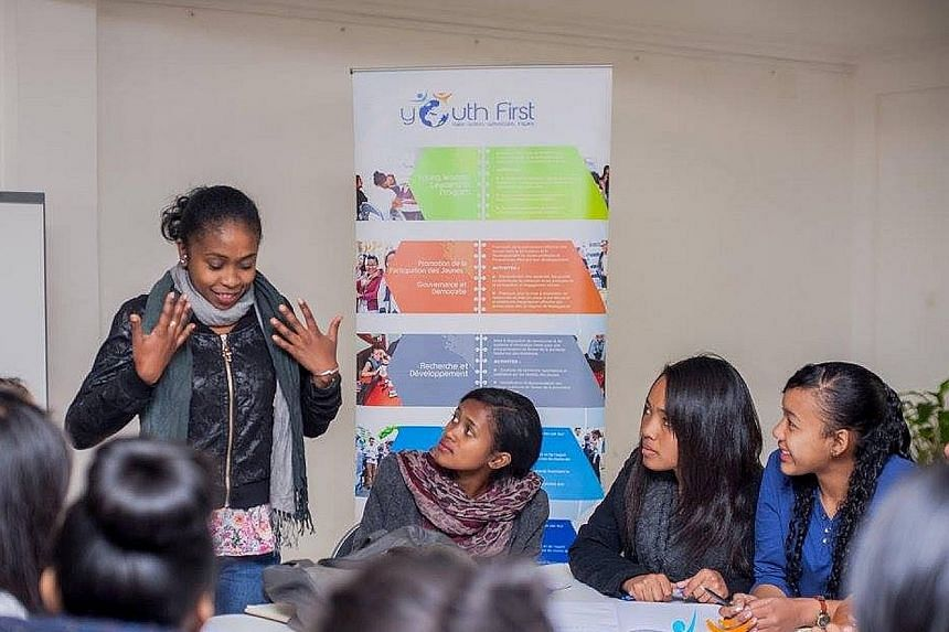 Participants at a Young Women Leadership Programme session playing a game aimed at developing communication skills.