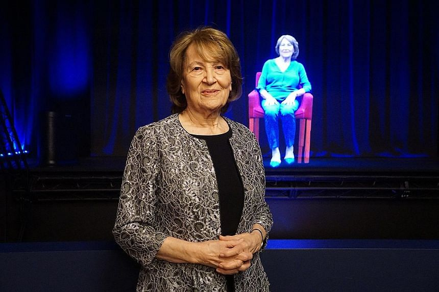 Above: Ms Fritzie Fritzshall, president of the Illinois Holocaust Museum and Education Centre, in front of her hologram.