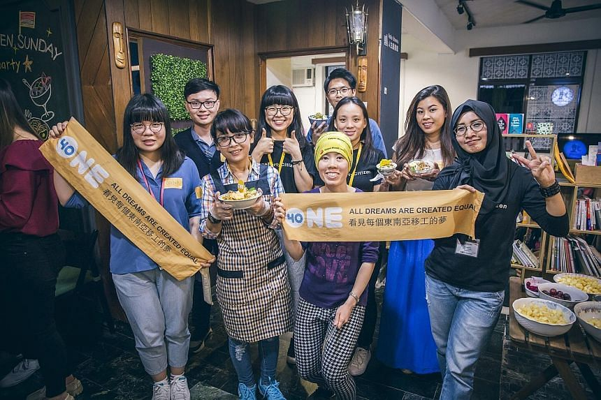 Putting their thoughts to paper: Wishes written by South-east Asian migrant workers during class. Migrant workers in Taiwan at One-Forty's monthly event, Open Sunday, where they get to socialise and share their culture with the locals.