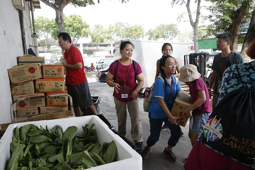 SG Food Rescue volunteers scour the Pasir Panjang Wholesale Centre to collect food items - mostly fruits and vegetables - that are edible but not considered good enough to sell because they are slightly blemished, discoloured or odd-shaped. The food