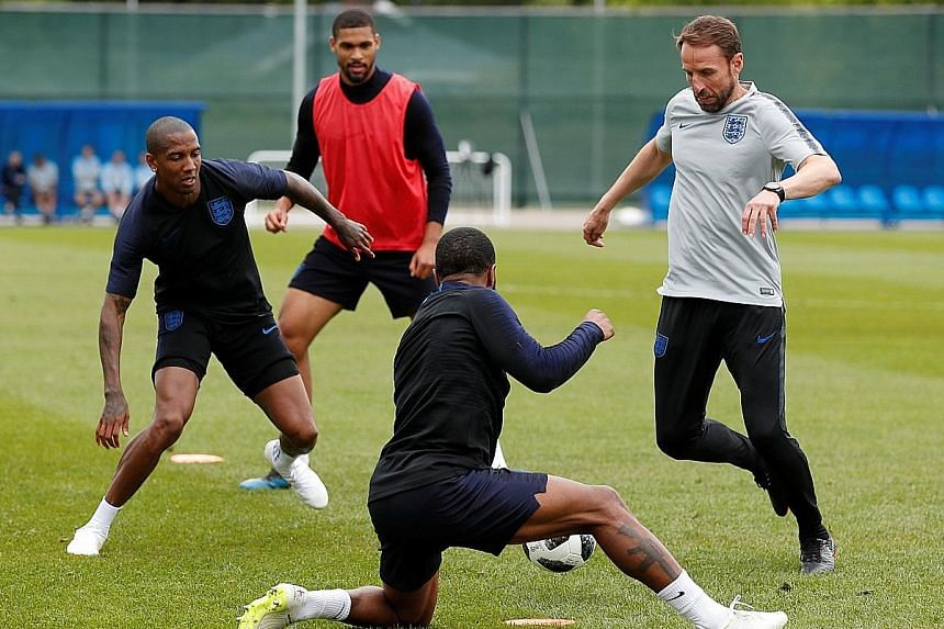From left: Ashley Young, Ruben Loftus-Cheek and Raheem Sterling training under the guidance of England manager Gareth Southgate.