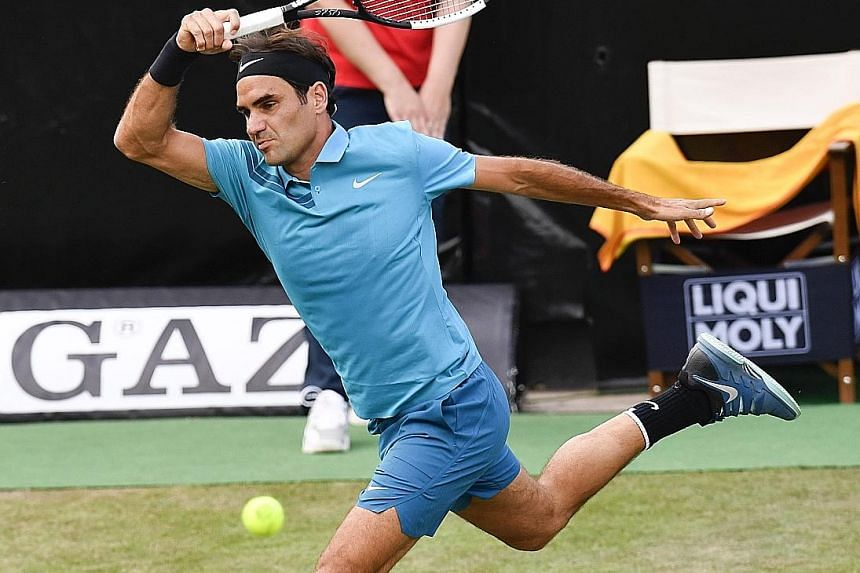 Swiss legend Roger Federer returning to Argentina's Guido Pella in their quarter-final at the Stuttgart Open. He will overtake Rafael Nadal to be No. 1 again if he reaches the final.
