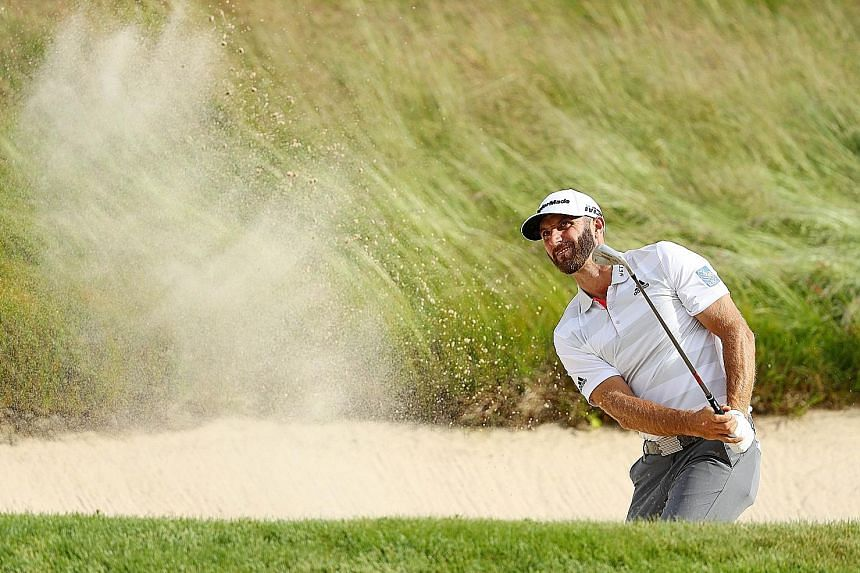 World No. 1 Dustin Johnson of the United States playing a bunker shot on the 14th hole during the first round of the 2018 US Open at Shinnecock Hills Golf Club on Thursday. He carded a one-under 69.