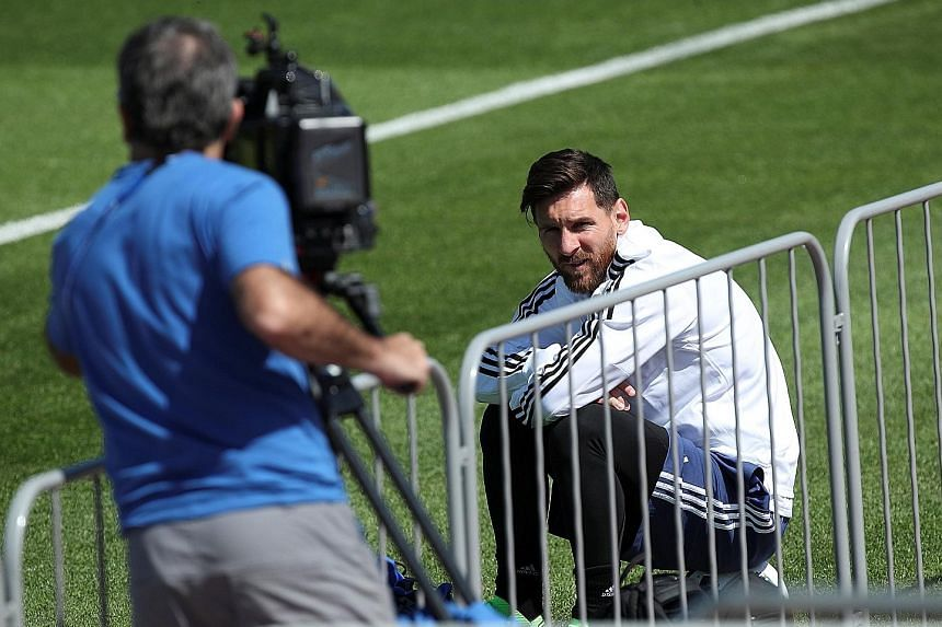 Lionel Messi taking a break during Argentina's training session yesterday. His team-mates have vowed to do everything in their power to give their talisman the World Cup success he craves.