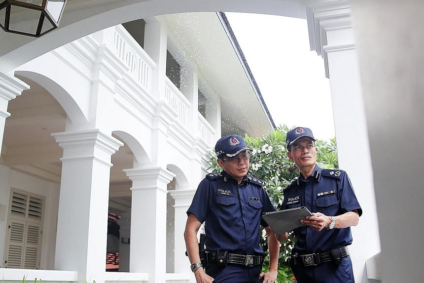 Assistant Commissioner Jarrod Pereira (right), commander of Clementi Police Division, and Superintendent Daniel Hui, Clementi police's head of operations, were involved in the operations at the Capella hotel.