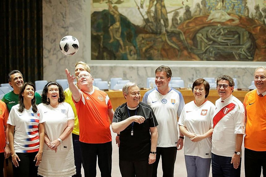 Members of the UN Security Council, including Russian Ambassador Vassily Nebenzia (with ball) and UN Secretary-General Antonio Guterres (in black), posing for a photo to mark the opening match of the World Cup on Thursday.
