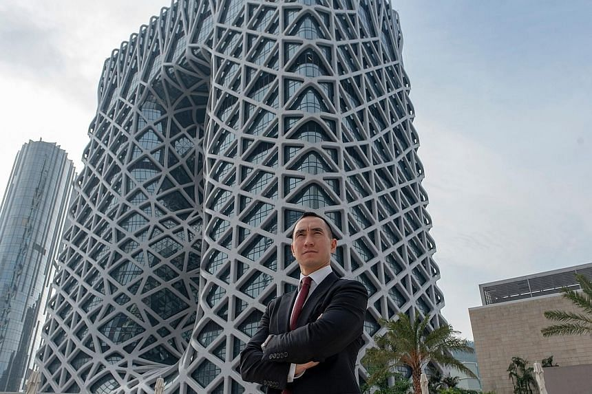 Melco Resorts and Entertainment chairman Lawrence Ho in front of the Morpheus resort, a flamboyant new casino in Macau designed by the late Zaha Hadid.