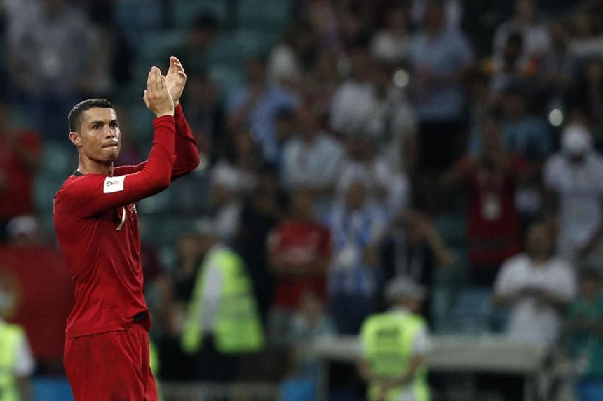 Portugal's forward Cristiano Ronaldo applauds to acknowledge fans at the end of the match between Portugal and Spain, on June 15, 2018.