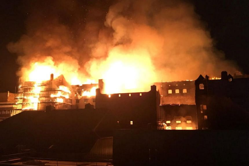 The rear elevation of the Glasgow School of Art is seen on fire, in Glasgow, Scotland, on June 15, 2018, in this still image obtained from social media.