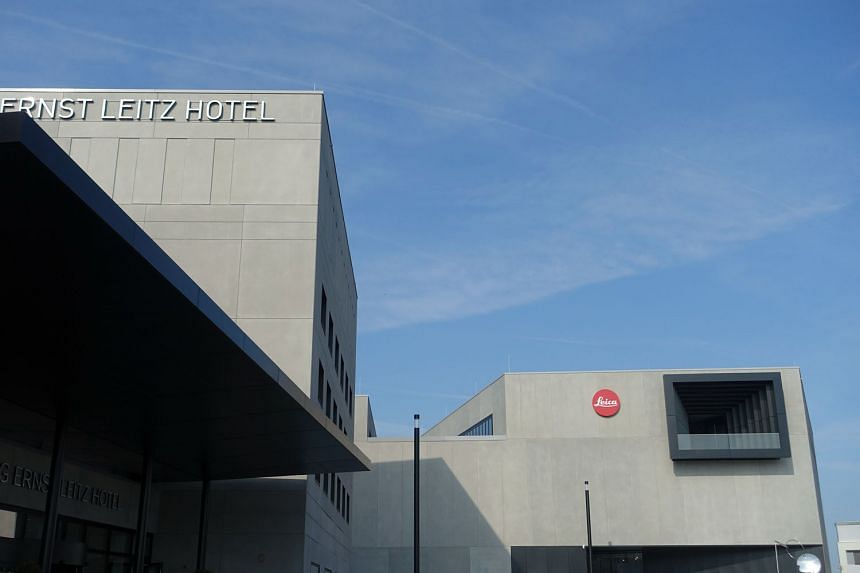 The balcony of Leica Camera AG building is modelled after the camera viewfinder (right) and the Ernst Leitz hotel operated by Arona Living has 129 rooms (left).