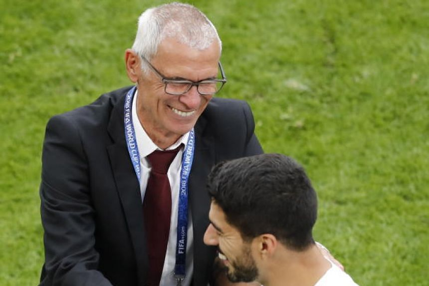 Head coach Oscar Tabarez of Uruguay and his player Luis Suarez celebrate after the FIifa World Cup 2018 group A preliminary round soccer match between Egypt and Uruguay in Ekaterinburg, Russia, on June 15, 2018.