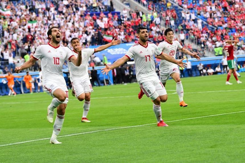 (From left) Iran's forward Karim Ansari Fard, Iran's forward Mehdi Taremi and Iran's forward Sardar Azmoun react after Morocco scored an own goal during the Russia 2018 World Cup Group B football match between Morocco and Iran at the Saint Petersburg