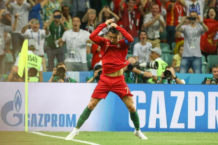 Cristiano Ronaldo of Portugal celebrates after scoring against Spain during the Fifa World Cup 2018 group A preliminary round soccer match between Portugal and Spain at the Fisht Stadium, in Sochi, Russia, on June 15, 2018.