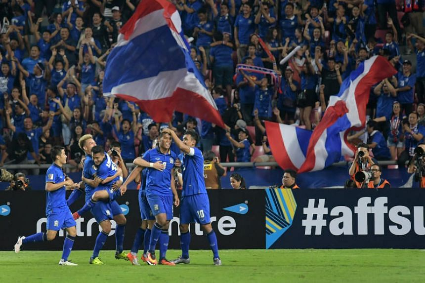 A file photo taken on Dec 17, 2016, shows Thailand's players celebrating their second goal against Indonesia during the Asean Football Federation Suzuki Cup final.