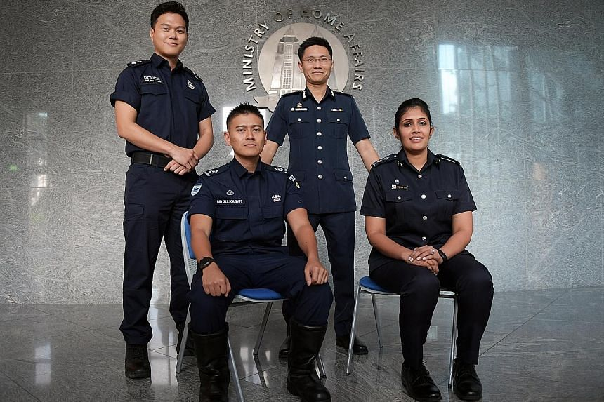 Home Team officers involved in the Trump-Kim summit: (from left) Inspector (NS) Gim Joo Hyung, Police Coast Guard; Warrant Officer 1 Mohammed Zulkasfyi Yunos, 35, emergency medical technician, Singapore Civil Defence Force; Director of Operations Sen