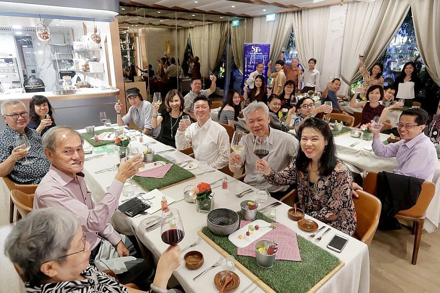 Six ST readers and their families enjoying a Father's Day dinner treat at Curate restaurant at Resorts World Sentosa. The meal boasted a showcase menu by chef Benjamin Halat and was hosted by Straits Times food critic Wong Ah Yoke.