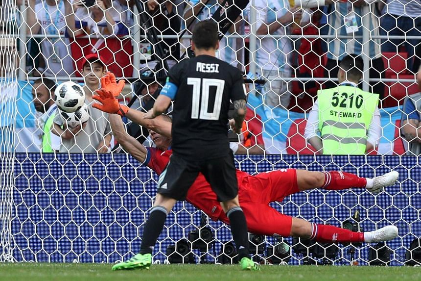 Iceland's goalkeeper Hannes Halldorsson saving the penalty taken by Argentina's Lionel Messi, rescuing his team from defeat at Spartak Stadium in Moscow yesterday.
