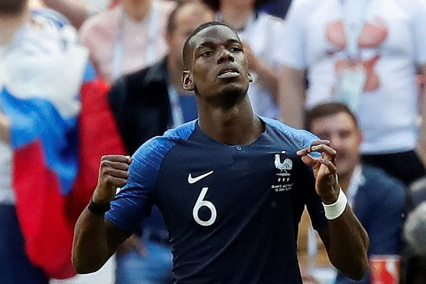 France's Paul Pogba celebrates after scoring his team's second goal, which sealed all three points, against Australia.