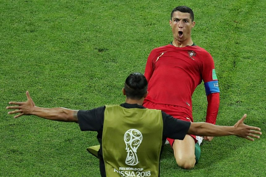 Cristiano Ronaldo celebrates scoring Portugal's second goal. He goes on to score their third with a free-kick in the 88th minute to deny Spain victory.
