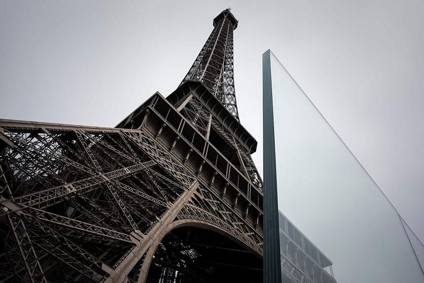 Among the new security measures at the Eiffel Tower in Paris are 6.5cm-thick glass walls (above) and 3.24m-high metal barriers (left).