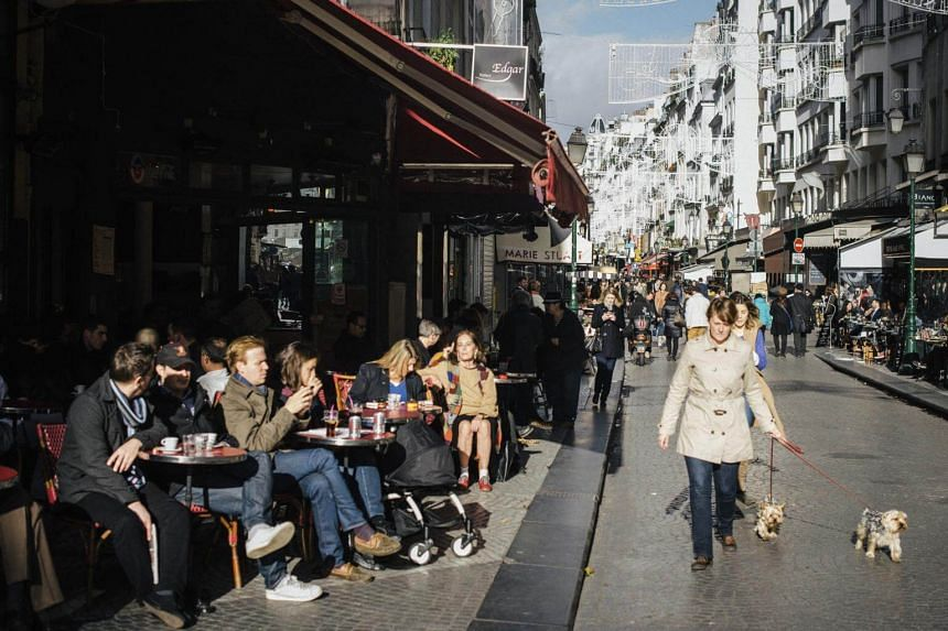 """A coalition of bistro owners, unions and trade organisations is lobbying to get Unesco to grant Paris' sidewalk bistros and cafes official status as France's """"intangible cultural heritage""""."""