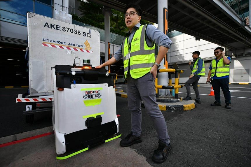 Director of Red Dot Robotics Joseph Lew demonstrating features of an autonomous guided vehicle at Changi Airport, on May 14, 2018.