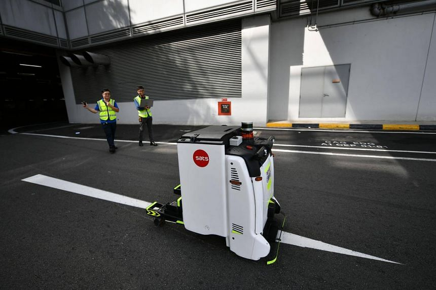 An autonomous guided vehicle on its way to pick up the container trailer of an aircraft at Changi Airport, on May 14, 2018.