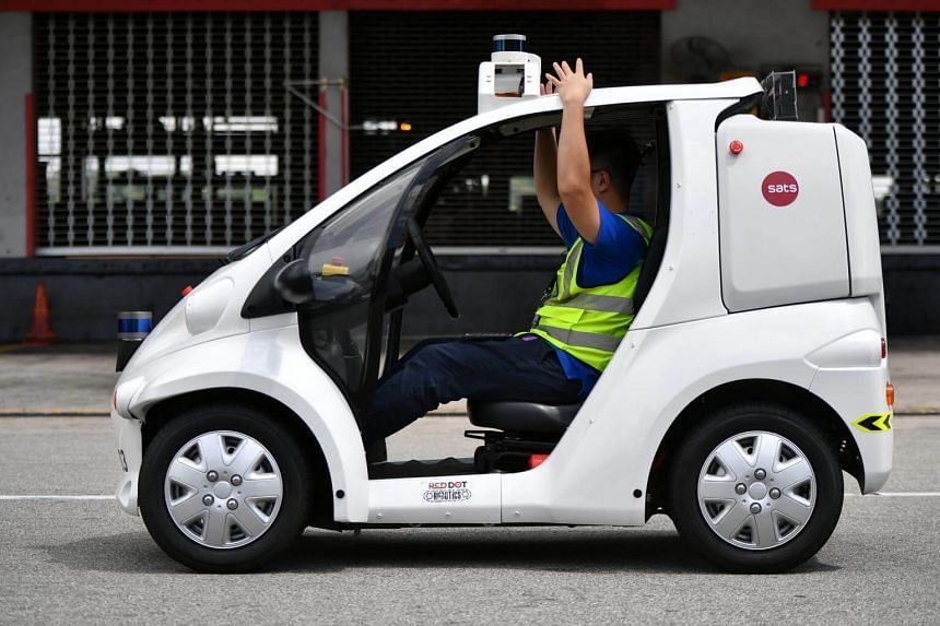 A driverless caddy used for cargo documents delivery between Sats airfreight terminals and the aircraft, on May 14, 2018.