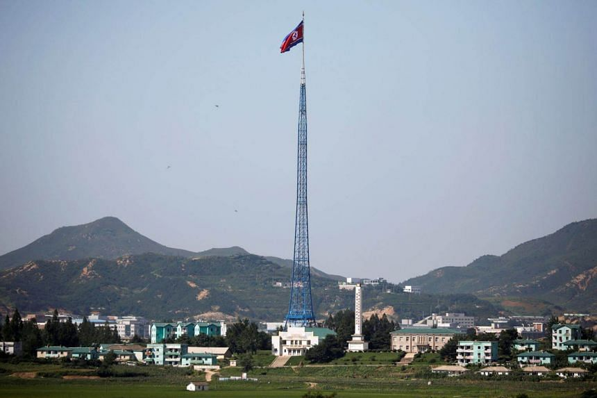 A North Korean flag flutters on top of a tower at the village of Gijungdong in North Korea, in this picture taken near the truce village of Panmunjom, South Korea, on Aug 26, 2017.