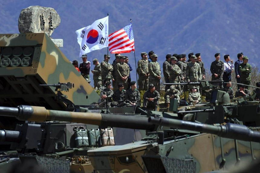 A file photo of South Korean and US soldiers watching from an observation post during a joint live firing drill between South Korea and the US at the Seungjin Fire Training Field in Pocheon, northeast of Seoul, on April 26, 2017.
