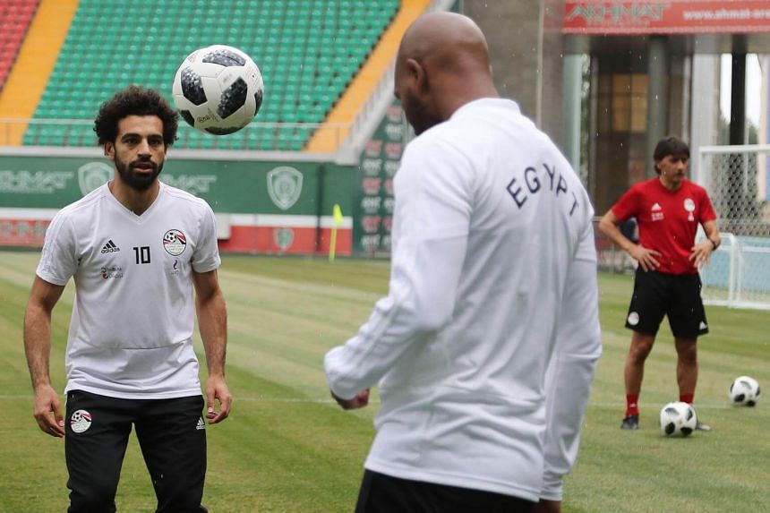 Egypt's super striker Mohamed Salah attended training on June 16 and was spotted employing the help of three teammates pulling on his top.