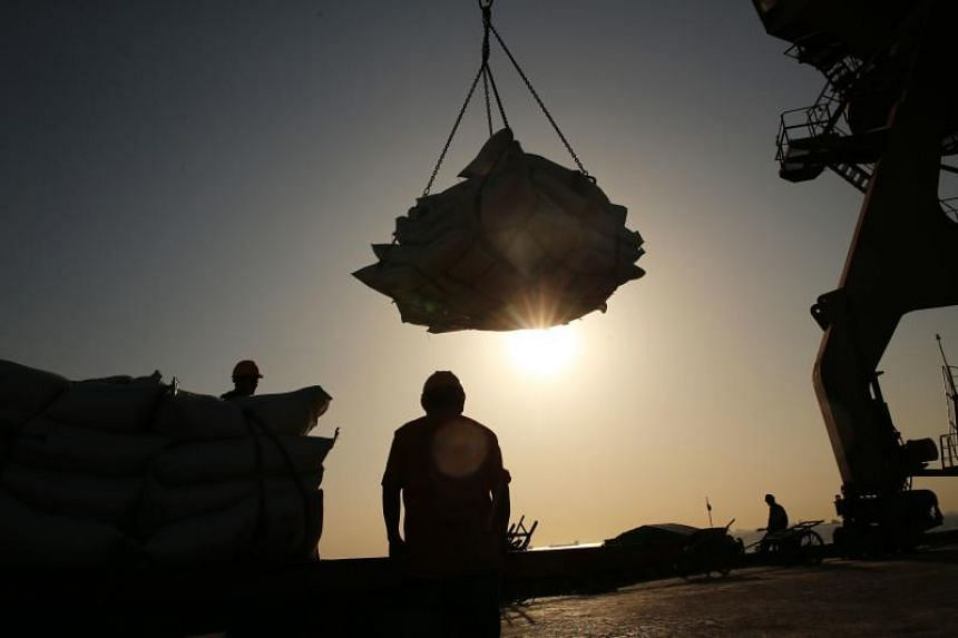 Workers transfer soybeans at a port in Nantong in China's eastern Jiangsu province.