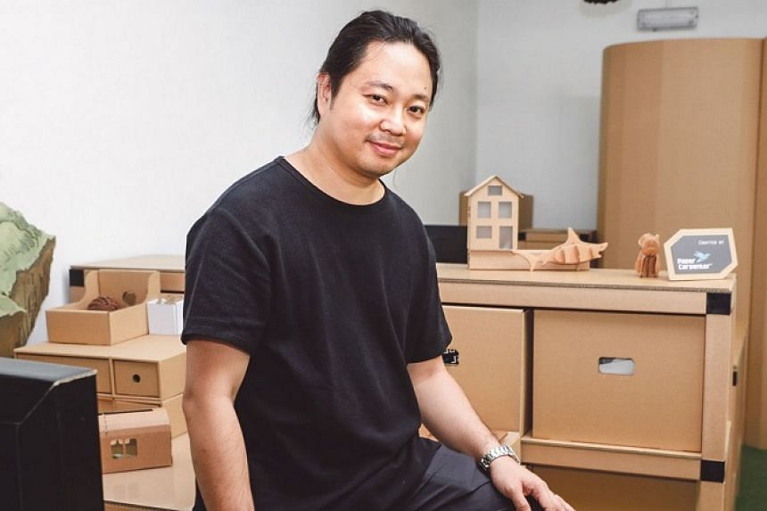 Mr Adrian Chua uses cardboard to build sculpture and furniture.