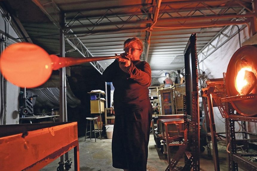 Glass artist B Jane Cowie demonstrates the art of glass-blowing.
