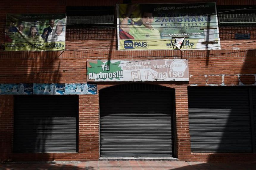 View from the outside of the nightclub, Los Cotorros, where at least 17 people died when a person activated a tear gas grenade inside, in Caracas on June 16. The deaths occurred after a brawl broke out during a middle school graduation party and some