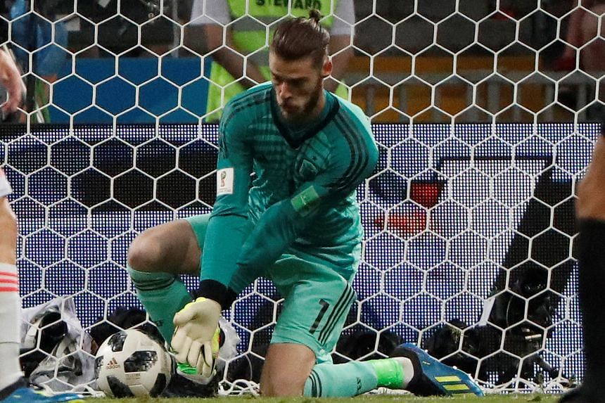 Spain goalkeeper David de Gea fumbles the ball from a Cristiano Ronaldo shot which allowed Portugal to go 2-1 up during the Group B match on Friday.