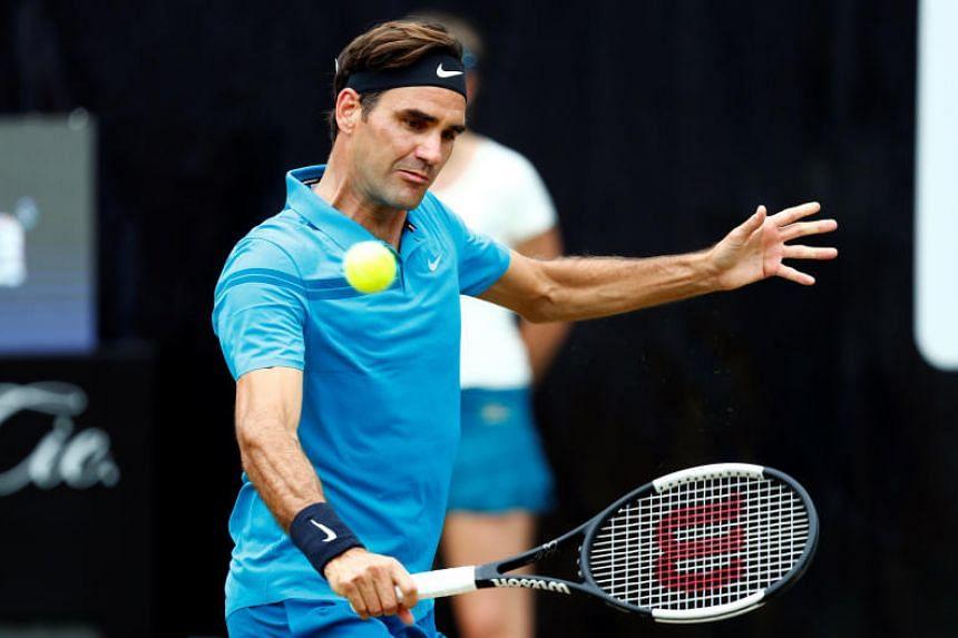 Roger Federer hitting a return to Milos Raonic during their match at the Stuttgart Open on June 17, 2018.