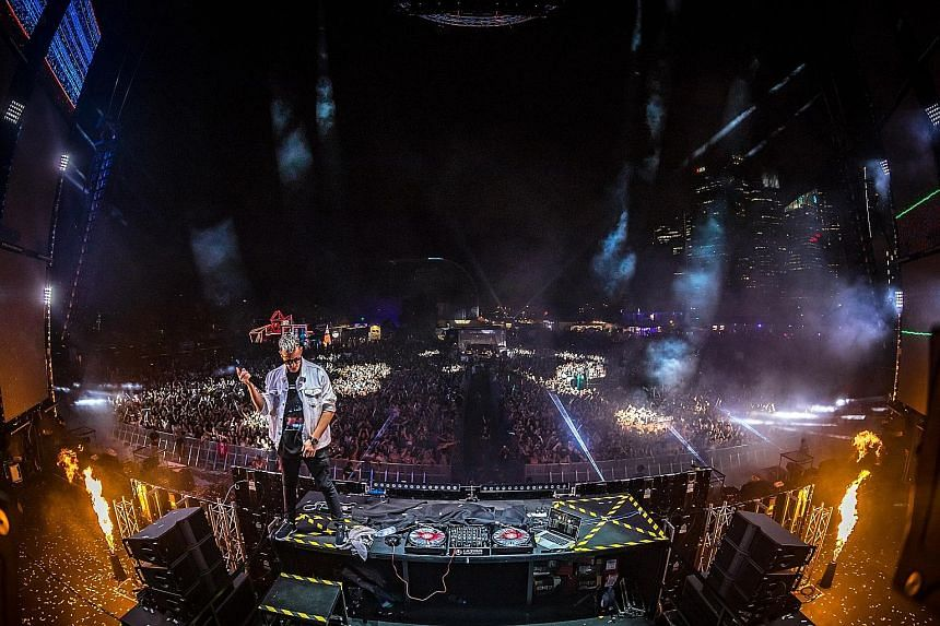 Ultra Singapore's main stage (above) featured pyrotechnics, confetti showers and lasers; and Frenchman DJ Snake (left) partied on the decks during his set on the first day of the festival.