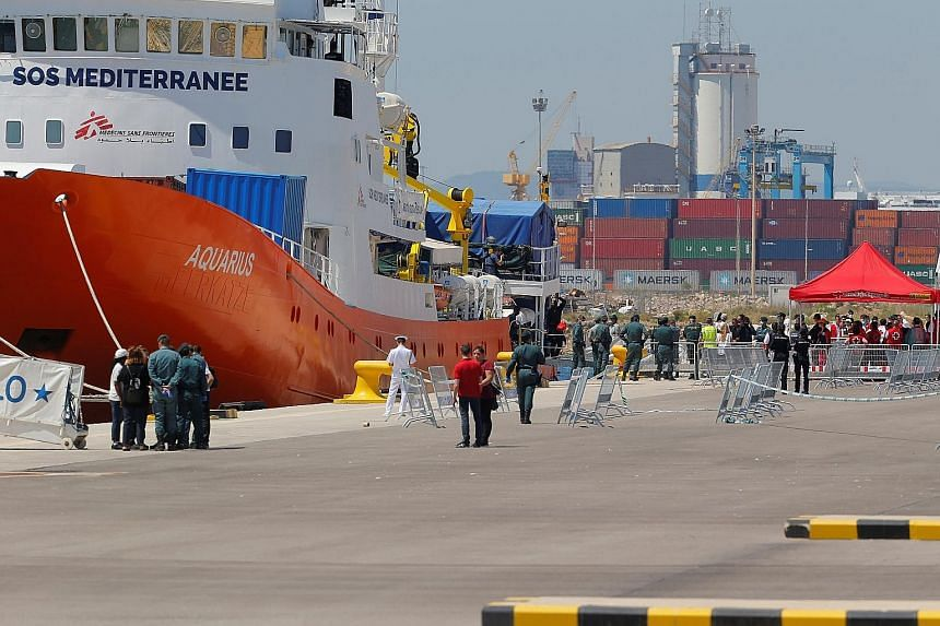 The Aquarius docked in Valencia as the 106 migrants on board disembarked to applause from police, health workers and translators waiting on the pier yesterday.