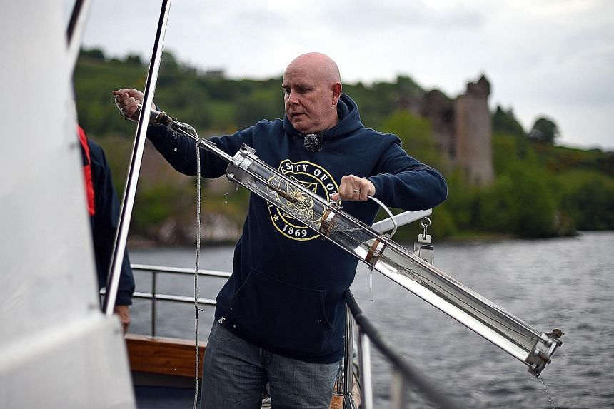 Professor Neil Gemmell takes samples on his boat as he conducts research into the DNA present in the waters of Loch Ness in the Scottish Highlands. Tales and reported sightings of a giant creature in the waters have been around for over 1,500 years.
