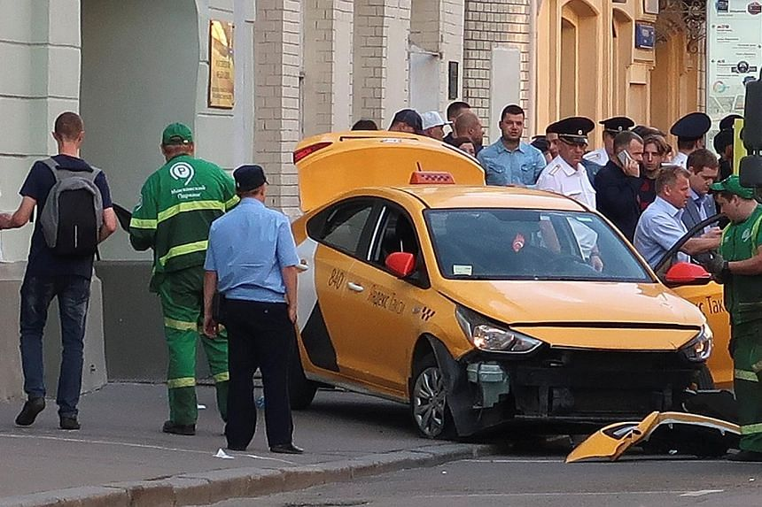 The cab mounted a pavement in central Moscow on Saturday, injuring at least seven people on the third day of the Fifa World Cup.