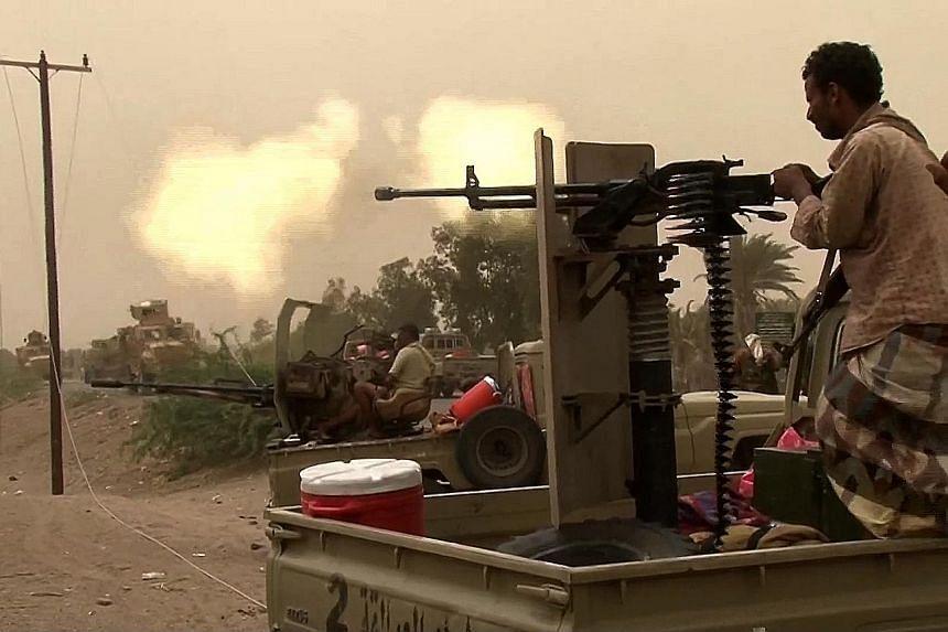 Yemeni pro-government forces firing heavy machine guns south of Hodeida airport last Friday. Yemen's military said it has seized the airport, though the rebels denied the claim. The UN is believed to be pressing the Houthi rebels to cede control of t